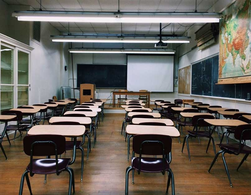 empty classroom with world map