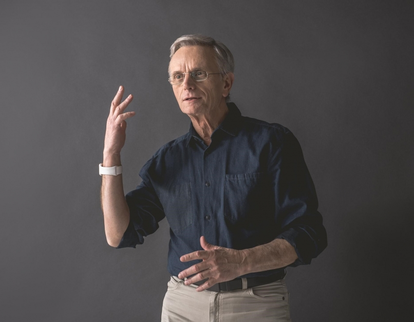 Assistant professor uses gestures while speaking.