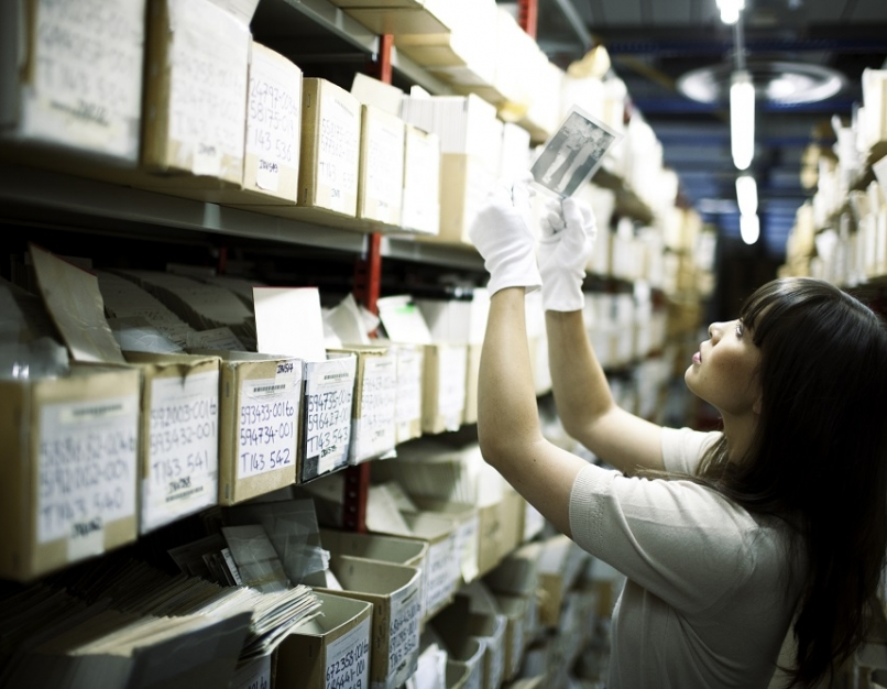 An archivist searches through pictures
